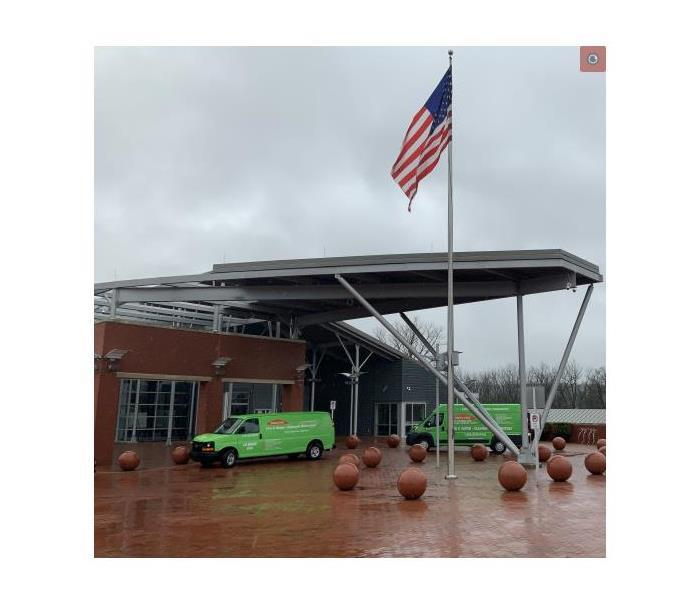 Servpro trucks out front local police station